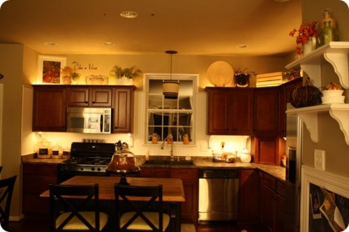lighting over kitchen cabinets - thrifty decor chic - Ideas For That Awkward Space Above Your Kitchen Cabinets