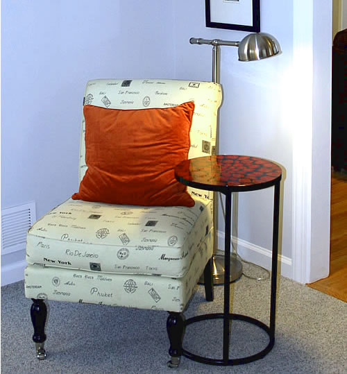 HomeGoods accent chair with orange pillow
