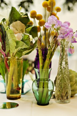 vegetables in assorted vases tablescape