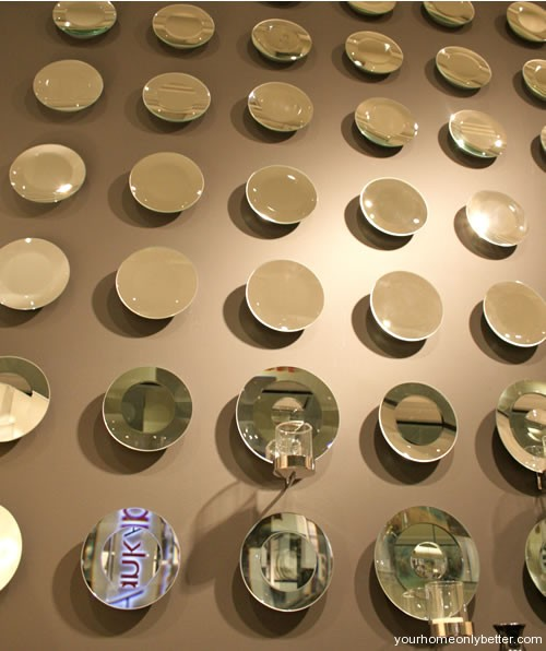 bowls mirrors and plates as wall art