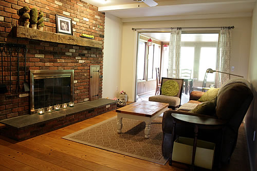 family room with brick fireplace and wide plank floor