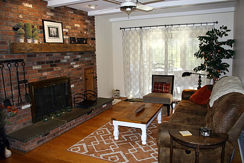 small narrow family room with brick red and orange rug