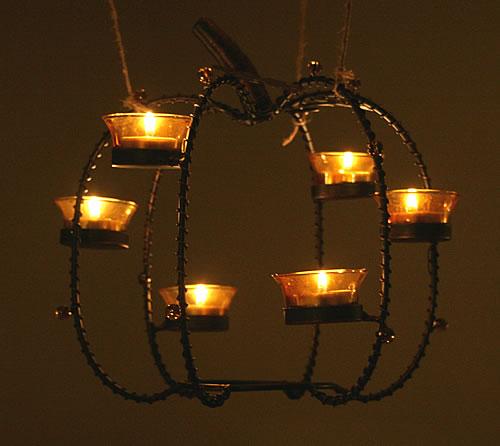 hanging pumpkin centerpiece at night
