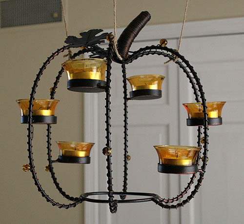 hanging a thanksgiving pumpkin centerpiece from chandelier