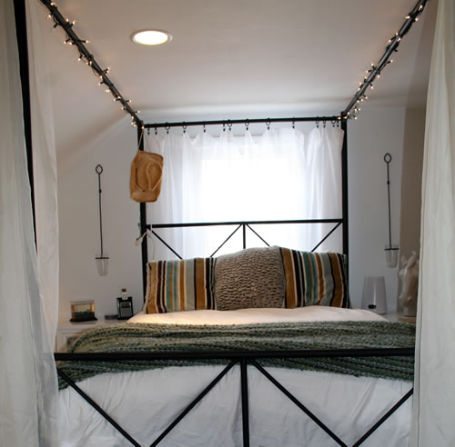 canopy bed in romantic country attic bedroom