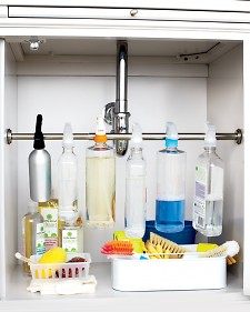 hanging cleaning supplies in a cabinet