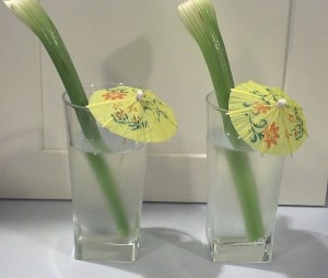 cucumber water with celery and cocktail umbrellas