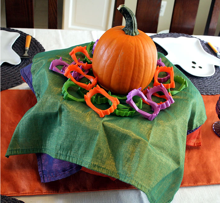halloween colorful napkins and pumpkin on cake stand